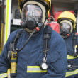 Stock Photo: Firefighters in protective workwear
