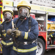 Firefighters in protective workwear — Photo