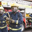 Firefighters in protective workwear - Stok fotoğraf