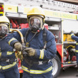 Firefighters in protective workwear - Photo