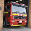 A fire engine leaving the fire station - Stock Photo