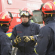 A firefighter giving instructions to his team — Stock Photo