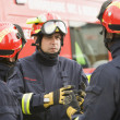 A firefighter giving instructions to his team - Stockfoto