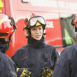 Stockfoto: A firefighter giving instructions to her team