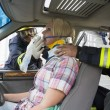 Firefighters helping an injured woman in a car — Stock Photo #4758357