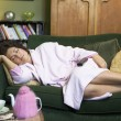 Young womlying on her couch having nap — Stock Photo #4758425