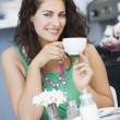 A young woman drinking tea in a cafe — Stock Photo
