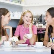 Royalty-Free Stock Photo: Young women enjoy tea in a cafe