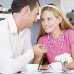 A young couple enjoying tea together — Stock Photo