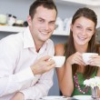 A young couple enjoying tea together — Stock Photo