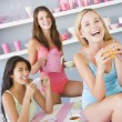 Three young women in their underwear having a tea party — Stock Photo #4758584