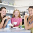 Young women enjoy tea in a cafe — Stock Photo