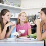 Young women enjoy tea in a cafe — Stock Photo