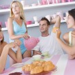 Group of friends enjoying sexy breakfast - Stock Photo