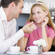 A young couple enjoying tea together - Stock Photo