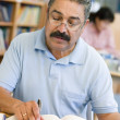 Mature male student studying in library — Stock Photo #4758853