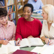 Mature students studying in library — Foto Stock