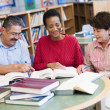 Mature students studying in library — Stock Photo