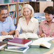 Mature students studying in library — Stock Photo #4758888