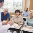 Mature students and their teacher in a classroom — Stock Photo #4758988