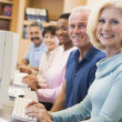 Mature students learning computer skills — Stock Photo