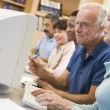 Stock Photo: Mature students learning computer skills