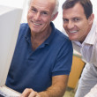 Mature male student learning computer skills — Stock Photo