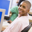 Schoolboy sitting in front of a computer in a high school class — Stock Photo