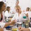 School children and their teacher in a high school science class - Stockfoto