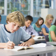 Schoolboy in high school class — Foto Stock
