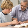 A teacher instructs a schoolboy in a high school class — Stock Photo #4759212