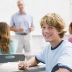A schoolboy in a high school class — Stock Photo