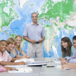 School children and their teacher in a high school class - Stock Photo
