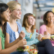 Stock Photo: Teenage girls enjoying healthy lunches together