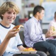 Teenage boys enjoying fast food lunches together — Stock Photo