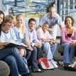 School children and their teacher in a high school class — Stock Photo