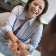 Woman shaking doctor's hand at IVF clinic - Stok fotoğraf