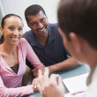 Stock Photo: Couple in discussion with doctor in IVF clinic