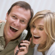 Stock Photo: Couple receiving good news over phone