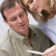 Couple looking at home pregnancy test — Stock Photo #4759483