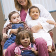 Consultant with three IVF toddlers - Stock Photo