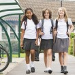 Stock Photo: Junior school children leaving school