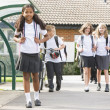 Junior school children leaving school - Stock Photo