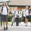 Junior school children leaving school — Stock Photo