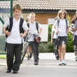 Junior school children leaving school — Stock Photo #4759505