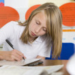 A schoolgirl studying in class — Stock Photo