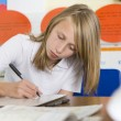 A schoolgirl studying in class — Stock Photo #4759515