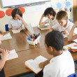 Stock Photo: Schoolchildren reading books in class