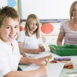 Schoolchildren and their teacher in an art class — Stock Photo #4759579