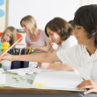 Schoolchildren and their teacher in an art class — Stock Photo #4759588
